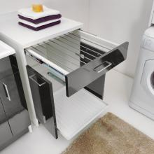 Laundry cabinet with extractable drying rack